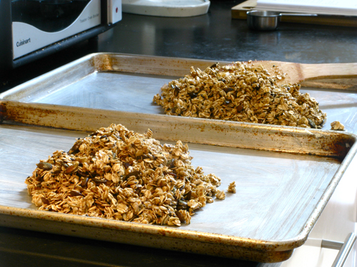 spread granola on rimmed baking sheets
