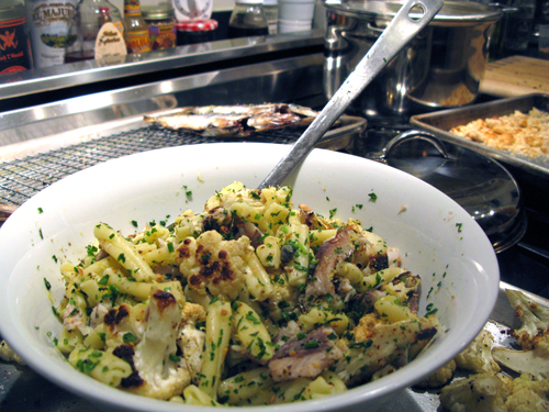 pasta tossed with grilled sardines cauliflower and crispy garlic bread crumbs