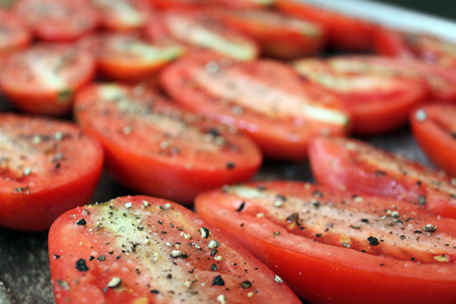 sprinkle cut tomatoes with sugar, salt and pepper